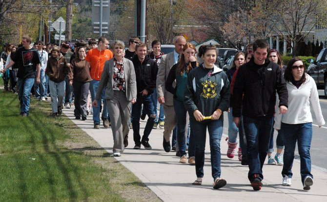 Elizabethtown-Lewis Central School junior Brody Hooper leads the walk during the Rally to Ban K2 in Elizabethtown April 30. Eight schools took part in the event.