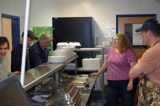 Members of the Westport Education Association serve breakfast to local volunteers April 28.