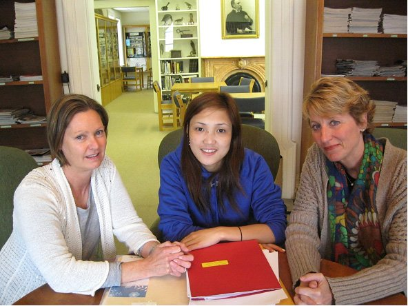 Chin Burmese refugee Esther Tial, center, consults with Cazenovia Public Library Literacy Coordinators Carla Zimmerman and Cindy McCall about the upcoming GED exam.  Esther is earning her GED as well as improving her English skills in the Library's expanded literacy program.