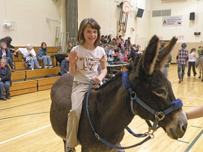 Chelsea Wright taking a leisurely ride around the MCS gym on a gentle donkey.
