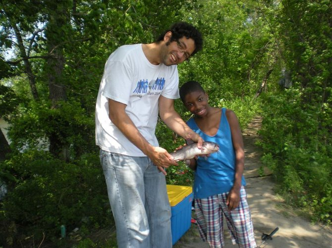 Big Brother Jorge with Little Brother NuRah on a fishing trip. Photo Submitted.