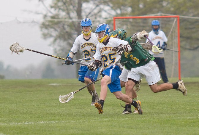 Defensemen Joe Colligan and Barclay Talbot run the ball out of the Cazenovia end during the May 1 game against Lafayette. Strong Laker defense kept the Lancers from ever getting close.