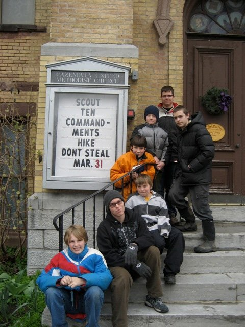 Cazenovia Boy Scouts pose for a photo outside the Cazenovia-Nelson United Methodist Church during their two-mile walk on March 31. Troop 18 traveled around town, gaining a deeper understanding of the Ten Commandments.