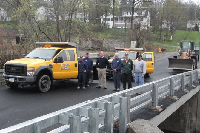 Cazenovia Village DPW workers Dave Cox, left, and Sam Usborne stand beside Tim Mahoney, Greg Stowell, Bill Carr and John Dunkle on the newly re-opened Clark Street bridge, May 1.