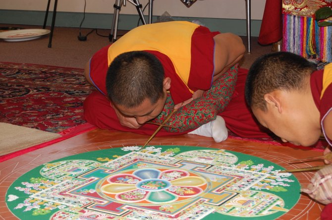 A Tsawa monk from India works on a sand mandala at the North Country Cultural Center for the Arts in Plattsburgh.