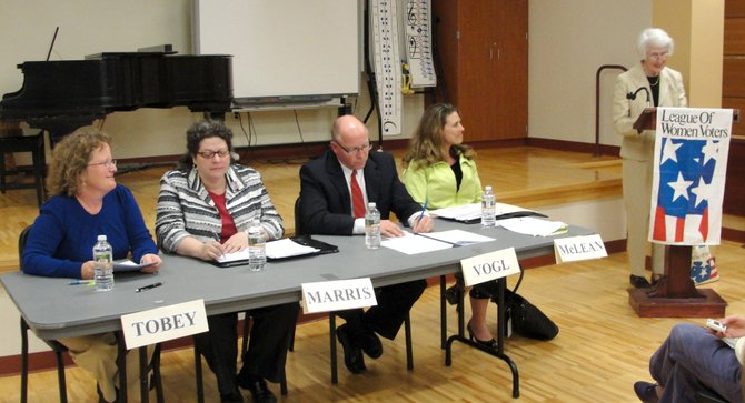 League of Women Voters of Cazenovia member Anne Redfern, right, poses audience-submitted questions to board of education candidates Cindy Bell Tobey, left, KARIN Marris, Pat Vogl and Nicole McLean.