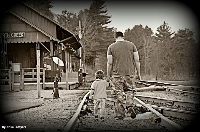Father (Juan Pesquera) and Son (Gabriel Pesquera) walking on the railroad tracks in North Creek