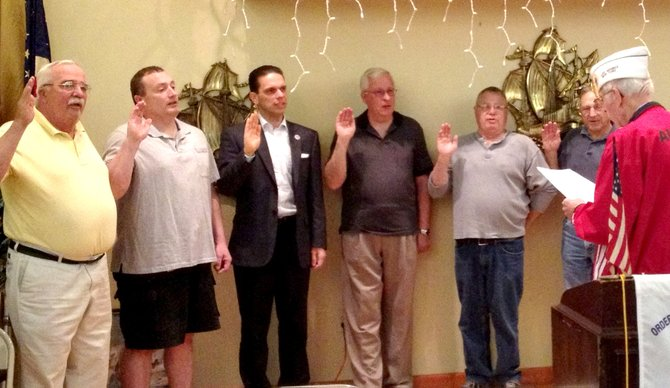 """E J"" Knapik, front right, swore in officers on Thursday, April 19, for the newly formed Rotterdam AMVETS Post No. 35. Being sworn in, from left, are Judge Advocate Robert Becker Jr., Finance Officer Michael McGrath, Commander Angelo Santabarbara, First Vice Commander Douglas VanIderstyne, Provost Marshall Fredrick Whelan and Second Vice Commander Anthony Guzzardi."