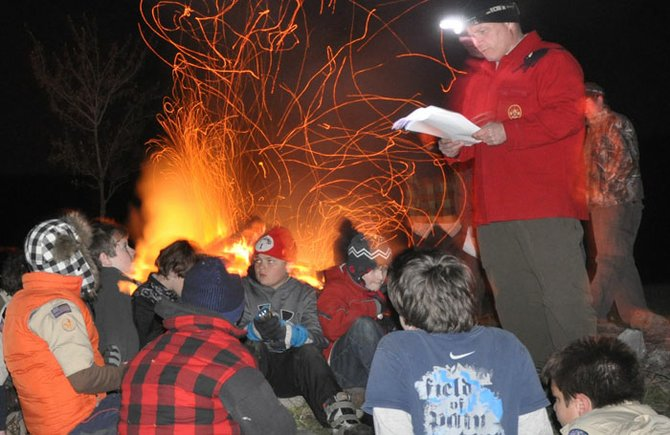 Assistant Scoutmaster Robert Sheppard passes down scouting stories by campfire during Operation Tenderfoot.