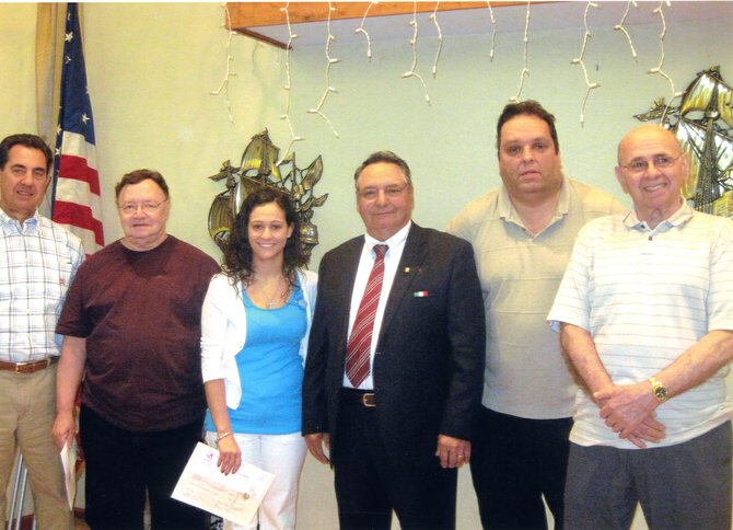 The Rotterdam Sons of Italy Lodge No. 321 reached 500 members after inducting five new members during its regular meeting on Monday, April 16. From left, Michael Pastore, Anthony Facci, 500th member Lorietana Pinto, President Louis Fazzone and Michael Mascitelli with his father, Gino.