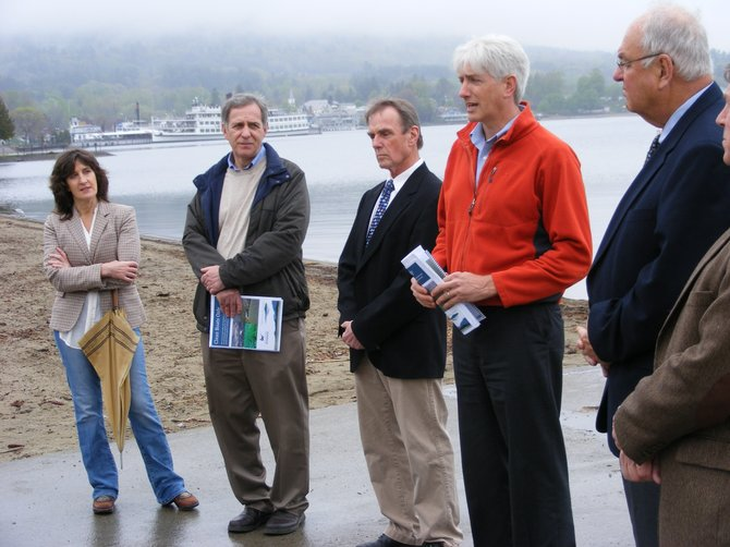 Peter Bauer of the Fund for Lake George (right center)  warns that if action isn't taken soon to stem the introduction of Asian Clams, milfoil and other nuisance species into the lake, efforts to control the spread of invasives is going to spiral in cost, as well as spoil recreation.  Joining Bauer in calling for the state to join local municipalities in imposing a mandatory boat inspection and decontamination program are (from left): Lake George town board member Marisa Muratori, Bolton Town Supervisor Ron Conover, and (at right of Bauer) Lake George Mayor Robert Blais and Queensbury Councilman John Strough.