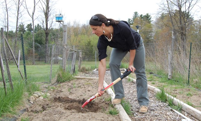 Allison Buckley tills the soil in her plot at the Elizabethtown community garden.