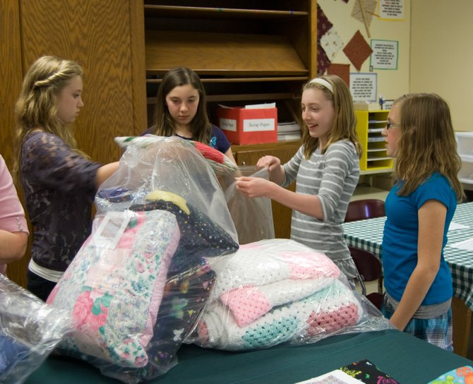 The Schalmont Middle School HUGS Club donated 20 quillows they made to the Ronald McDonald House in Albany on Monday, May 7.