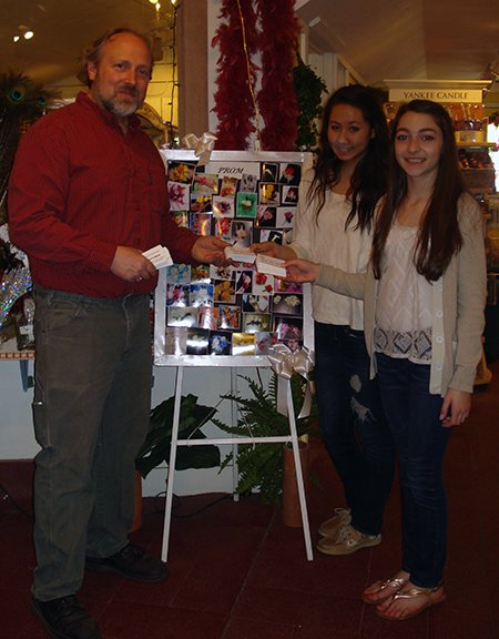 "Niskayuna eighth graders Rose Parisi (far right) and Olivia Kim, co-presidents of the local Medical Youth Alliance, deliver ""Think, Don't Drink"" cards to Felthousen's Florist in Schenectady."