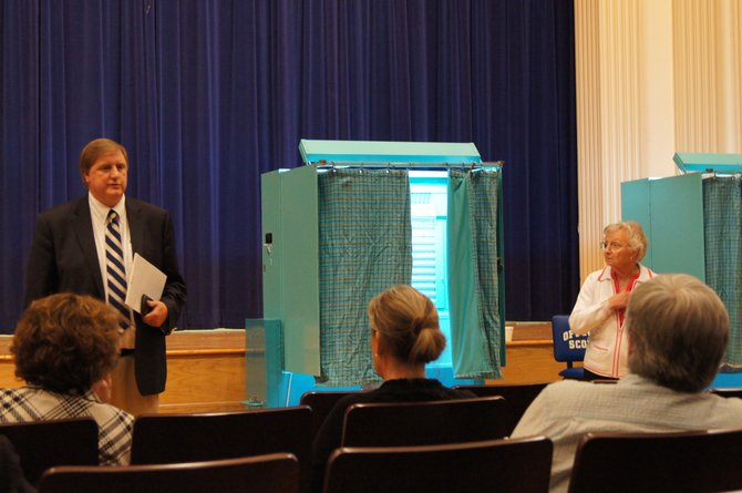 Cazenovia Central School District Assistant Superintendent Bill Furlong prepares to read the results of the district vote on May 15 in the high school auditorium.