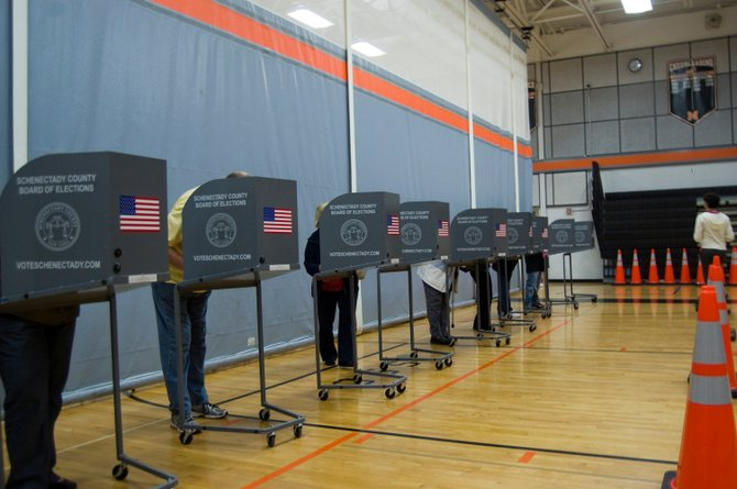 Voters cast their ballots at Mohonasen Central School District&#39;s gymnasium on Tuesday, May 15, for the proposed 2012-13 budget, bus proposition and Board of Education candidates in an uncontested race.