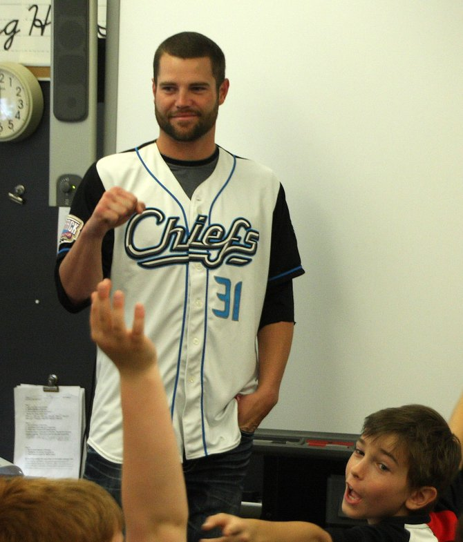 Syracuse Chiefs pitcher Josh Wilkie talks with Roberts School students about the importance of eating healthy and staying fit.