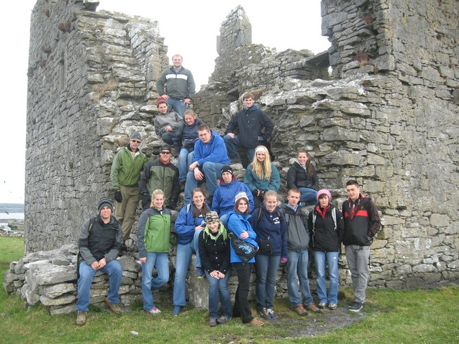 IRISH CASTLE RUINS - From left, front row at bottom are Liam Harrison, Meghan Sponable, Mikalya Glode, Shannon Ovitt, Chelsea Gazaille, Colleen Fuller, Nick Porter, Ashley Loomis, Chet Prouty. In middle row, teachers Pete Gilbertson and Steve Tomb, Dylan Moore, Ethan Cooper, Kala Williford, Sierra Galusha. Top group: Jessi Yates, Jon Ordway, Lydia Knickerbocker, Matt Hayden.