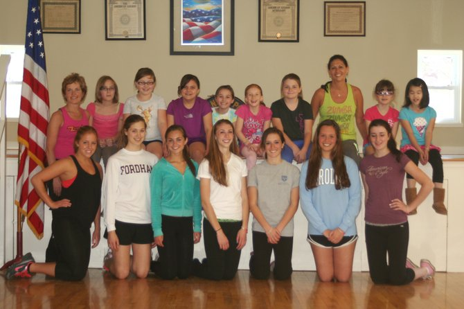 Zumba instructor Patty Trunko, back left, poses alongside Samantha Morris, Tessa Carroll, Margaret Kmetz, Josie Avery, Julia Buader, Molly Brown, Instructor Vira Reith, Erica Howard and Mae Braaten after completing a workout on April 29 in the Cazenovia American Legion Hall. In front, are Project CAFÉ members Marissa Barrett, left, Lila Seeley, Kathleen Connellan, Lucy Shephard, Lauren Devine, Sally Langan and Samantha Fox.