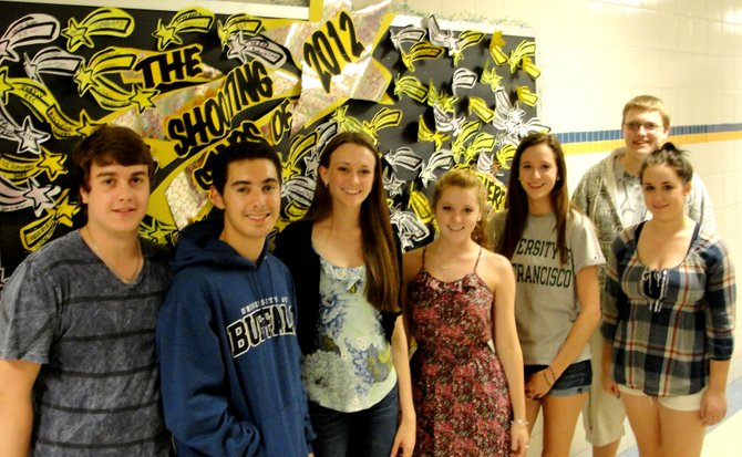 """Cazenovia High School Seniors Nick Eshbaugh, left, who will attend Champlain College; Molson Rousell, who will attend the University of Buffalo; Chloe Edelstein, who will attend Butler University; Mary Kate Conely, who will attend Oswego State University; Shelby Chase, who will attend Roger Williams University; Lisa Coleman, who will attend Morrisville; and Eric Rasmussen, who will attend the University of Buffalo, stand in front of the wall of """"shooting stars."""""""