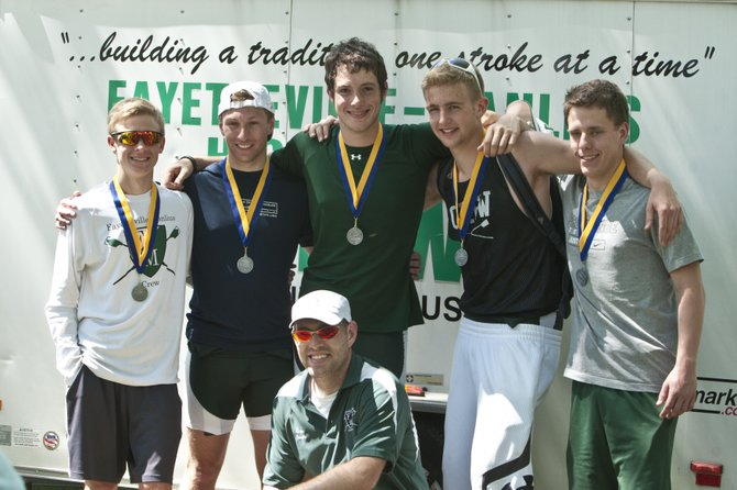 The Fayetteville-Manlius senior Boys 4+ crew, who won the silver medal during the May 11-12 state championships at Saratoga Springs. Kneeling: coach David Cusano. Top row, from left: Sawyer Konys, Chris Warren, Garrett Tongue, Connor Williams, Graham Ritchie.