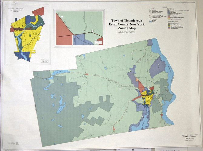Proposed changes to the Ticonderoga zoning law are on hold. The town board has appointed a committee to review the proposed revisions after learning the town planning board is too busy to complete the task.