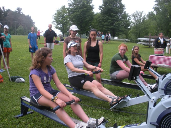 Members of the Cazenovia Rowing Club demonstrate aspects of the rowing stroke to prospective members during the 2011 Learn to Row clinic.