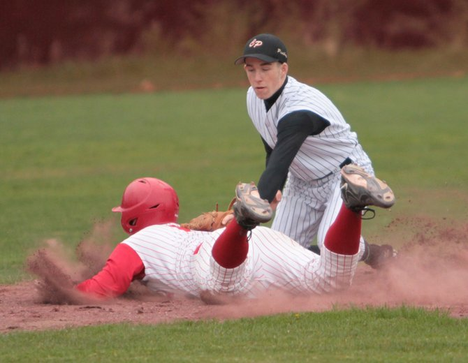 Schroon Lake's Jeff Armstrong slides as Crown Point's Gabe Macey applies the tag. Crown Point clinched the Mountain and Valley Athletic Conference Division I championship with a 14-4 win against Schroon Lake May 21.