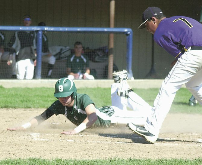 Schalmont's Dan Bergami slides across home plate to score on a wild pitch during last Saturday's Colonial Council game against Voorheesville. The Sabres beat the Blackbirds 14-7 to lock up the No. 2 seed for the Section II Class B playoffs. Schalmont plays in Thursday's quarterfinal round.
