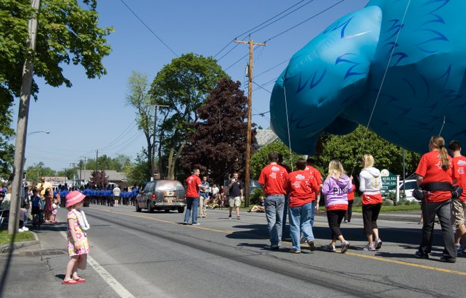 Caroline Kruggel, a 3-year-old from Niskayuna, watches the big Cookie Monster float pass by during the parade.