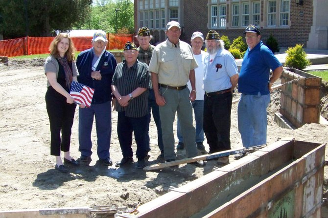 After Chestertown area veterans gathered May 18 to observe progress on the new Chester Veterans Memorial, they accepted a U.S. flag flown over the Capitol from Shay Mason, an aide of U.S. Rep. Chris Gibson. Participating in the presentation were (left to right): Shay Mason and veterans Harry Bollback, Lou Russo, Ron Robert, Bill Linton, Harry Brundage, Harry Smith and Joe Slattery.