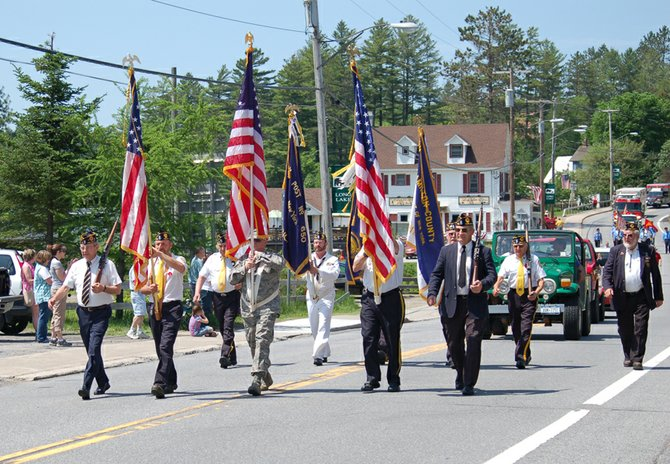 Veterans march in the 2011 Memorial Day parade in Long Lake.