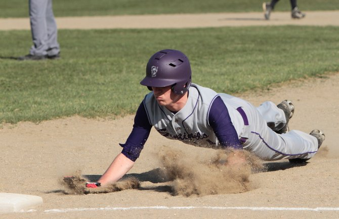 Nate Lenhart drives back into first base safely. Ticonderoga won the Champlain Valley Athletic Conference Division II championship with a 3-0 win against AuSable Valley May 22. Lenhart had two hits in the game for Ti.