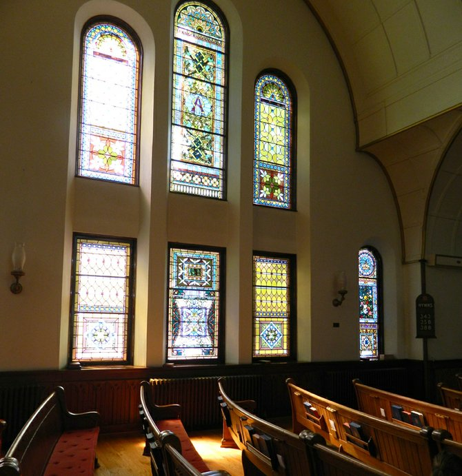 The 34 stained glass windows in the Sanctuary of the First Presbyterian Church offer vivid and colorful arrays of light at different times of day. The windows on the west side of the church, pictured here, illuminate the interior in the afternoons.