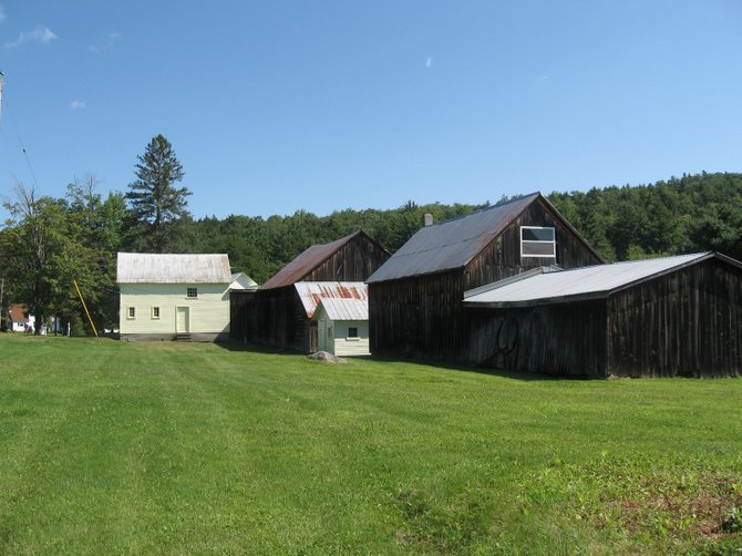 A cluster of barns at former Orley Needham farm, now an event venue known as Burlap & Beams, provides a charming backdrop for weddings and special events.