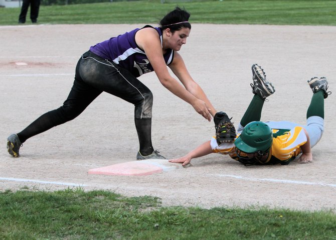 Ticonderoga's Megan Campney applies a tag as Northern Adirondack's Autumn Rabideau dives back into first base during Section VII Class C softball tournament action May 25. Ti won, 14-1, to advance to the section championship game.