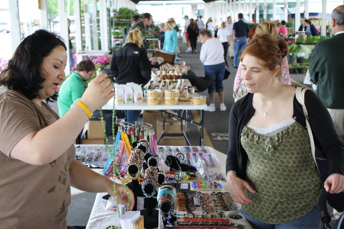 Shoppers browse the Capital District Farmers' Market in Menands on Broadway. The market opened May 5 and features both retail and wholesale markets. The retail market runs Saturdays from 9 a.m. to 1 p.m. and the wholesale market is Monday, Wednesday and Friday mornings.