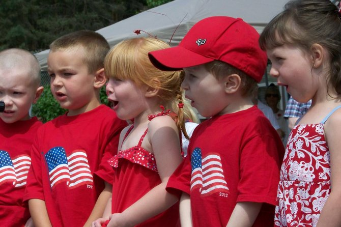 Singing a patriotic anthem during Memorial Day ceremonies Monday May 28 in Chestertown are  youngsters of Creative Opportunity Day Care, a local enterprise.