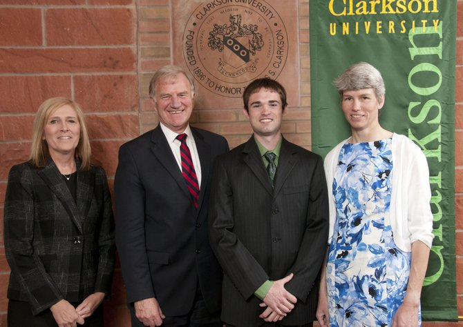 Clarkson University Vice President for University Outreach and Student Affairs Kathryn B. Johnson, left, President Tony Collins and Thomas Wilkowski honor Elizabeth Carpenter, right, with the Inspirational High School Educator Award on May 12.