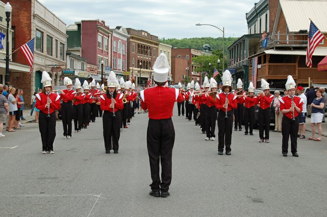 The Saranac Lake High School Marching Band plays during the Memorial Day parade on May 28.