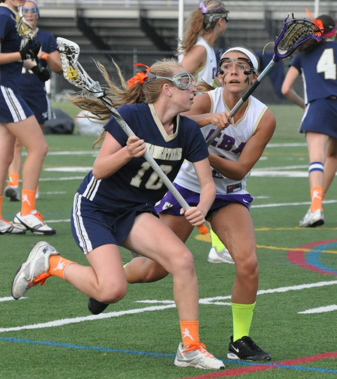 Skaneateles sophomore Casey VanSlyke (10) tries to work her way around CBA's Alyssa Pitonzo (1) in Tuesday night's Section III Class C final. VanSlyke had a second-half goal, but it wasn't quite enough as the Lakers lost to the Brothers 9-8.