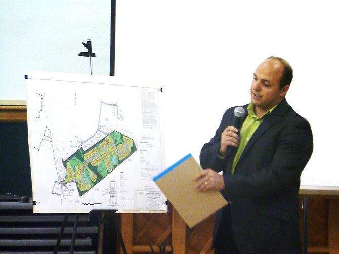 Luigi Palleschi, an engineer with ABD Engineers and Surveyors, presents the modified Hamden Woods housing development plan to the Bethlehem Town Board on behalf of  Raymond.