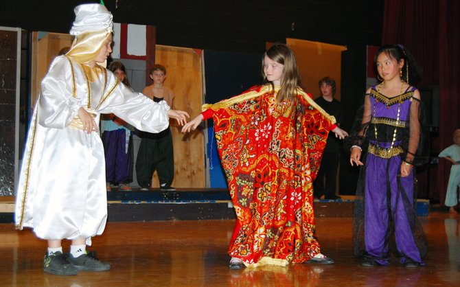 "Willsboro Students Oliver Lee as Aladdin, Mackenzie Martin as the Avis the Magic Carpet and Joelle Steeves as the Genie rehearse a scene from the upcoming play ""Aladdin Jr."""