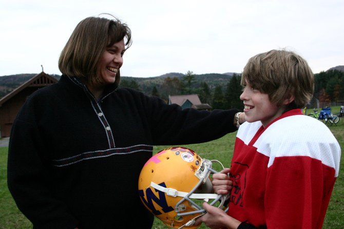 Laura Moore ,who won a national grant of $5,000 for Warrensburg Elementary to develop an asthma awareness program, greets her son Thomas — who has asthma — after a football practice last fall. Laura Moore and her husband Dean manage their two children's asthma, while encouraging them to be active in various sports.