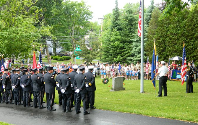 The Skaneateles Memorial Day parade stopped at Lakeview Cemetery to lay wreaths and offer a prayer.
