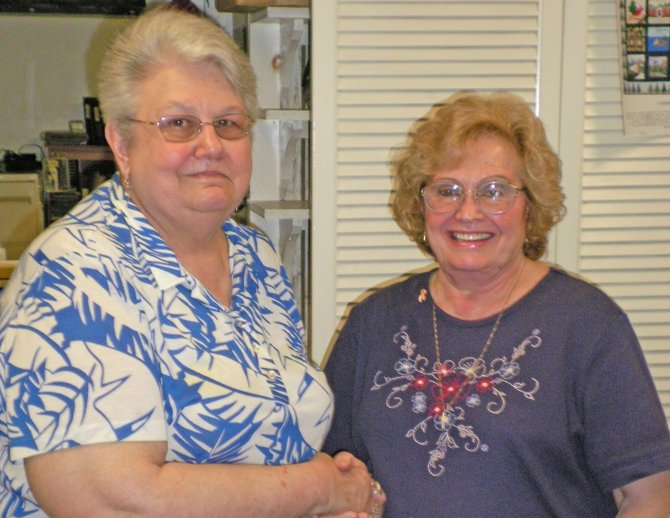 Kate Huston, right, the 2012 Schroon Lake Citizen of the Year, is congratulated by Rosemarie Ritson of the Schroon Lake Chamber of Commerce.