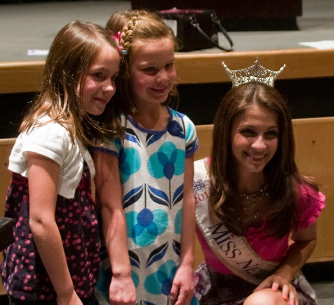 From right, Miss NY 2011 Kaitlin Monte poses for a photo with Mohonasen kindergarten students Leah Scalise and her friend Haley Rider. Monte talked to Draper Middle School students about her anti-bully campaign earlier on Friday, May 18.