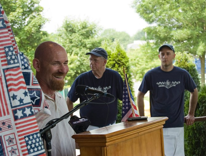 Scotia Mayor Kris Kastberg talks before the unveiling of Freedom Park's 2012 season schedule as Mark Lansing Sr., owner of Jumpin' Jack's, stands with his son, Mark Lansing Jr., in the background.