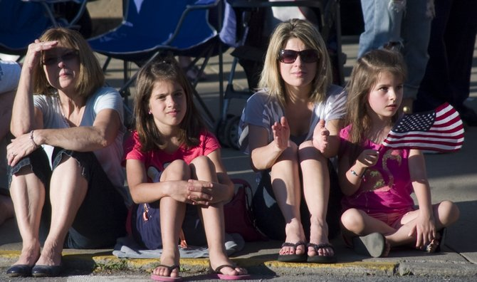 From left, Nancy Mortensen, Molly DiCaprio, Gianna DeLuke and her daughter, Renee, watch the parade while sitting in front of the Scotia Fire Department.