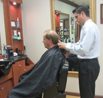 Master Barber Gregory Zorian, III of Gregory's Barbershops of Clifton Park and Delmar, tending to longtime customer Tom Lynch.